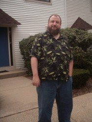 This pic is 5 years old, but other than being a little grayer in the beard I still look more or less the same.